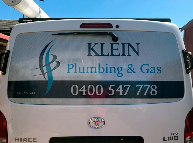 One way car window signage for Klein Plumbing and Gas