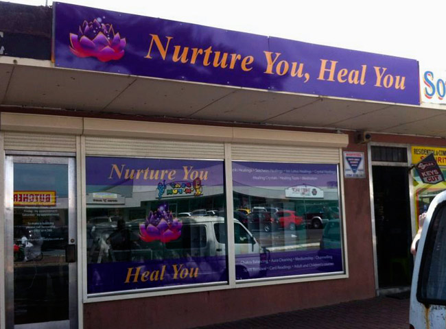 Window signage for Nurture You Heal You